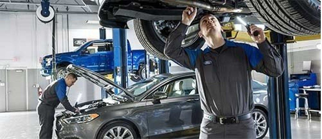 ford Technicians fixing the vehicle
